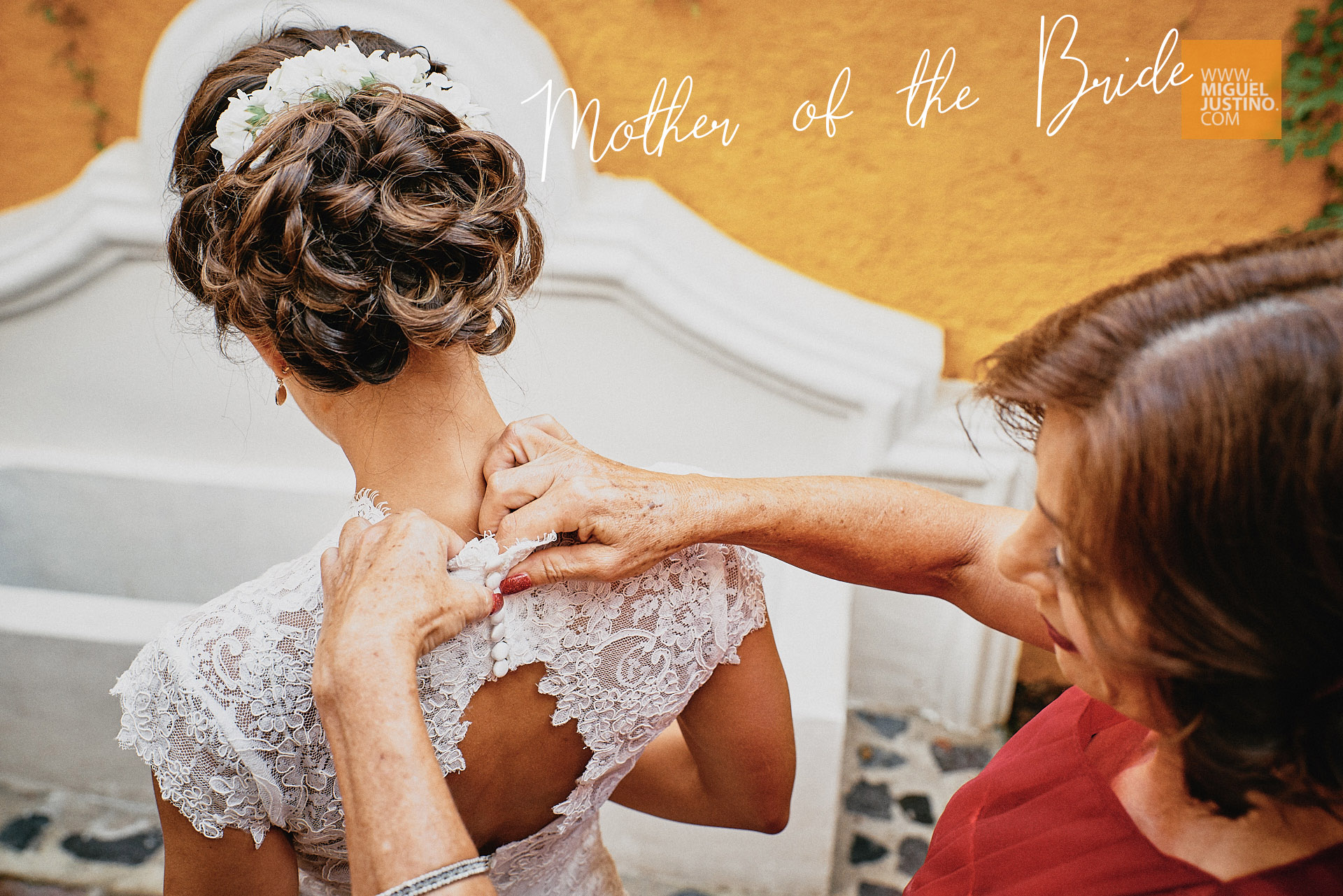 Mother of the Bride helping Bride with dress